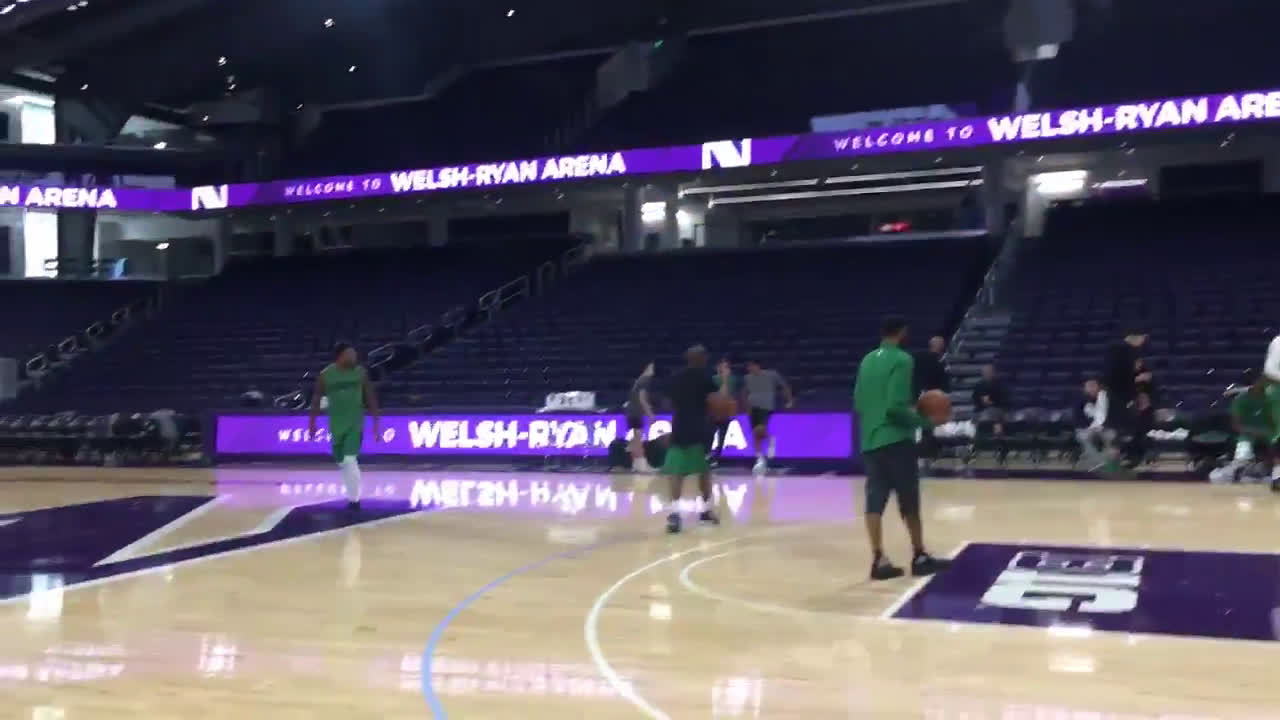Marcus Smart swishes half-court shot and does a backflip.