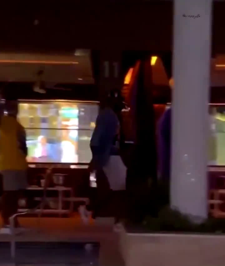 LeBron in Vegas walking with the Larry O'Brien trophy into the club for the Lakers championship party