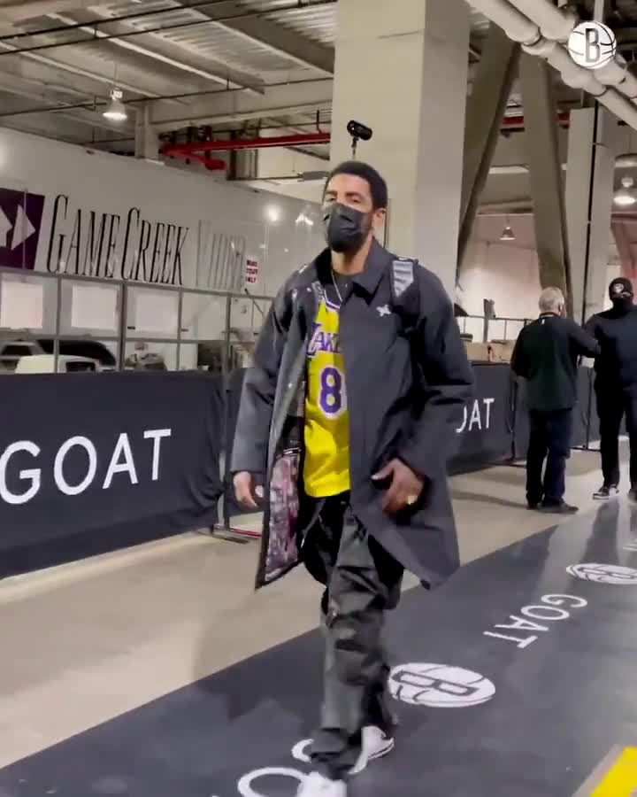 "Kyrie Irving paying homage to the late Kobe Bryant as he enters the arena for the Nets game against Heat: ""You know who I was rockin' tonight."""