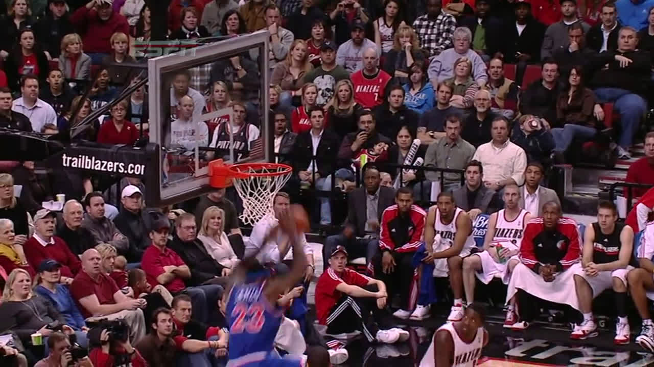 Lebron casually jumps high enough for his head to reach halfway on the backboard