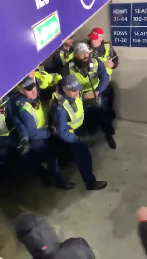Close-up video of Wembley police being pushed out of away end by Hungarian fans