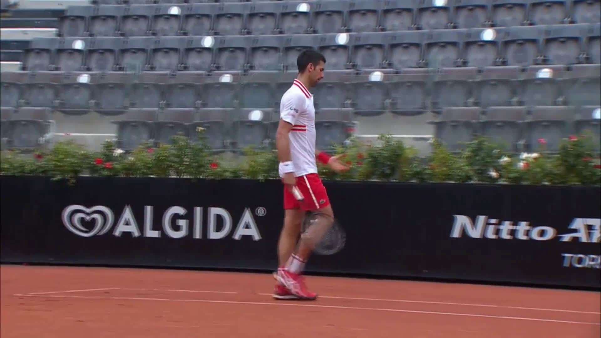 Djokovic screaming at the umpire to stop the play after getting broken when serving for a match against Fritz in heavy rain
