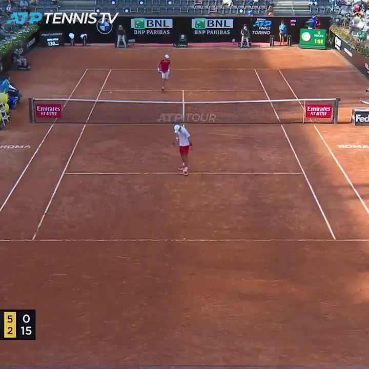 Djokovic clears a half volley just over the net